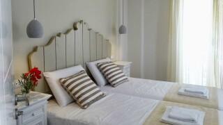 deluxe rooms anassa suites bedroom