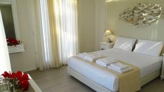 deluxe rooms anassa suites elegant bedroom